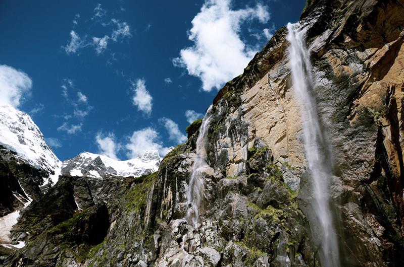 The Sacred Waterfall (Shenpu) of Yubeng Village in Deqin County, Diqing