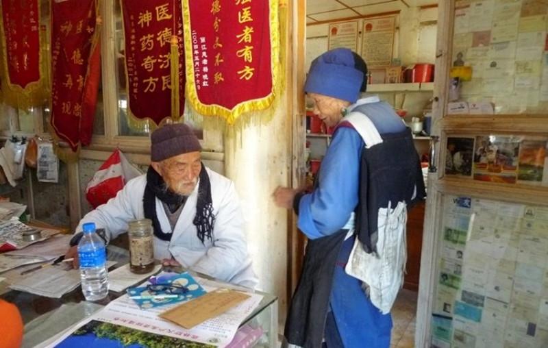 Doctor Ho Shixiu in Baisha Ancient Town, Lijiang