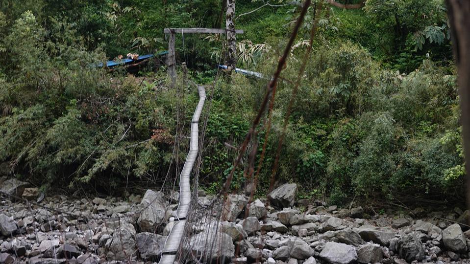 An old wooden bridge in Bopo Village, Dulongjiang Township, southwest China's Yunnan Province