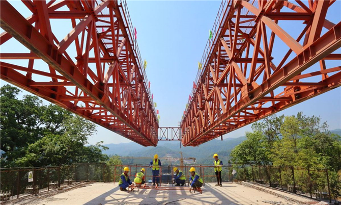 Employees work on the China-Laos railway project in Kunming, Yunnan province