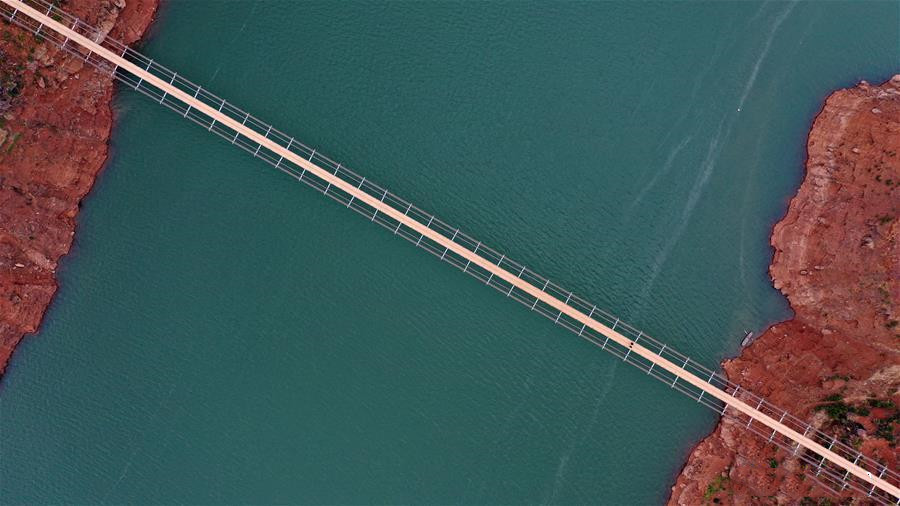 Aerial photo taken on Dec. 11, 2019 shows a bridge spanning the Niulan River in southwest China