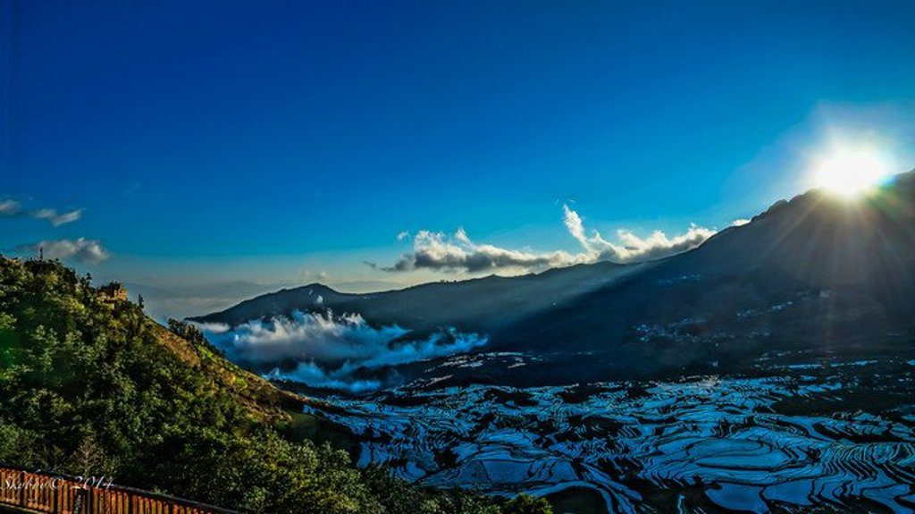The Scenic View of Sunrise in Duoyishu Rice Terraces